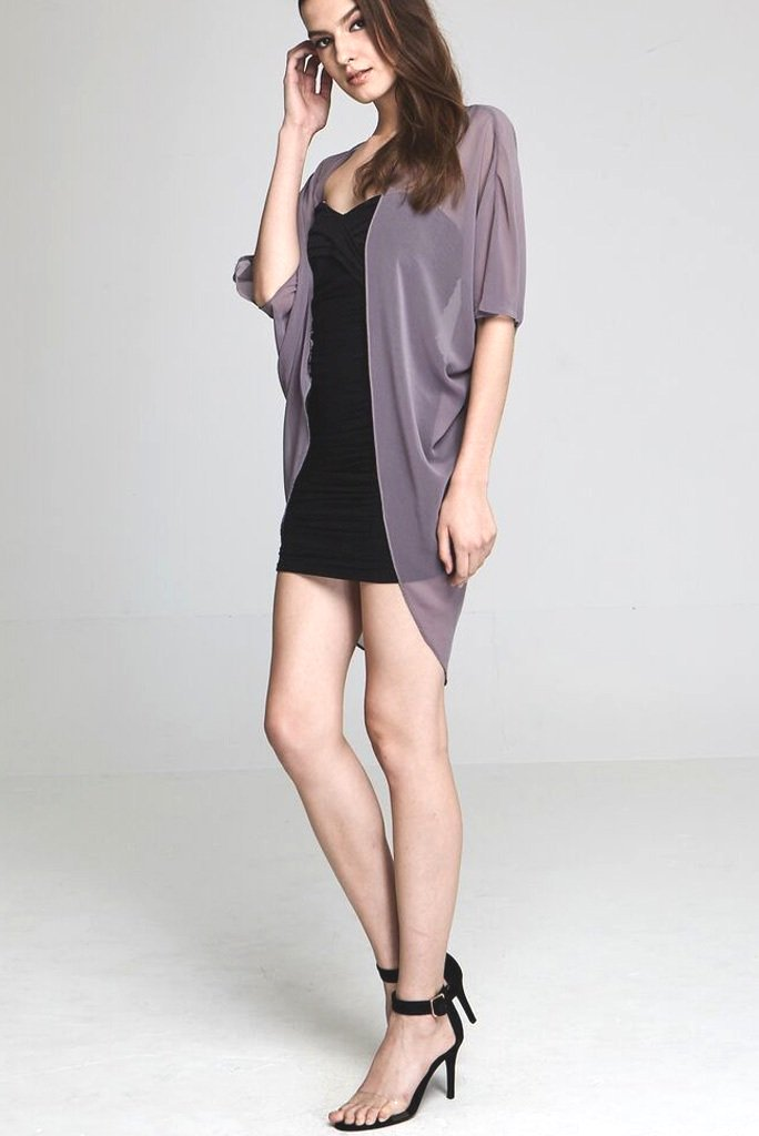 Model wearing short grey chiffon kimono facing sideways