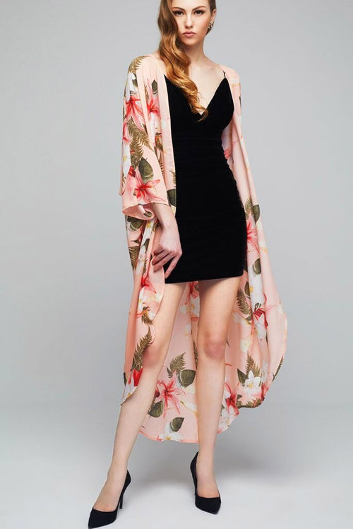 Model wearing long pink kimono with floral prints