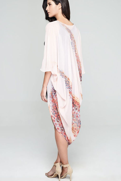 Model wearing pink chiffon kimono with sweet floral prints facing back