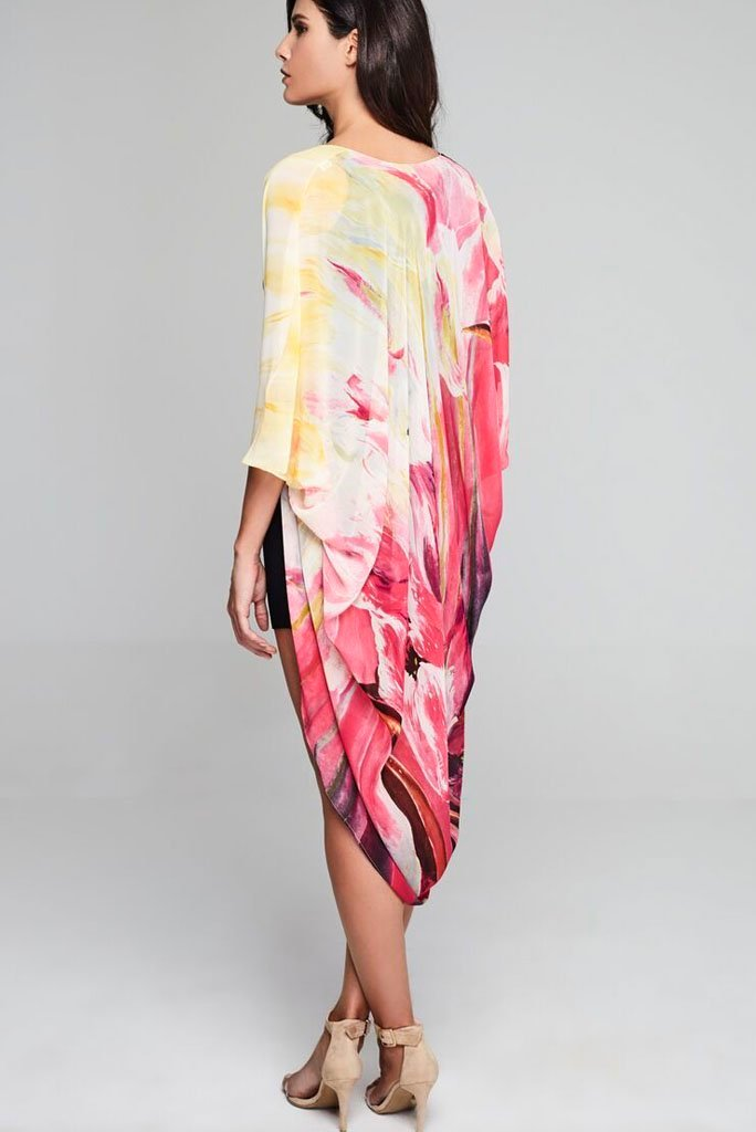 Model wearing pink & cream kimono with abstract prints facing back
