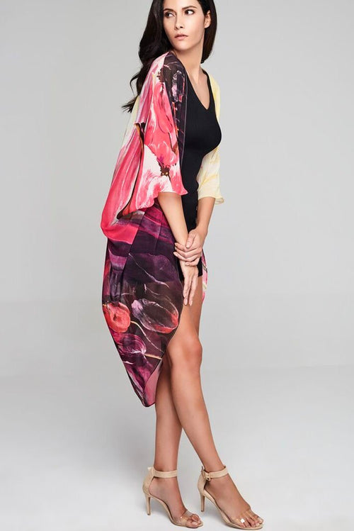 Model wearing pink & cream kimono with abstract prints facing right