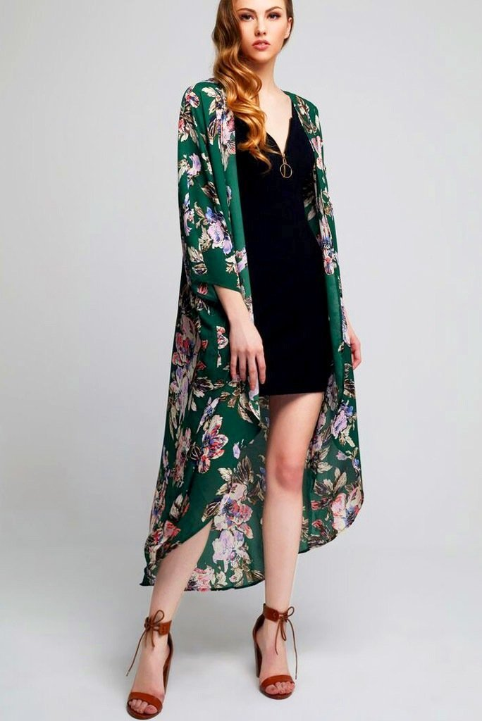 Model wearing long green kimono with floral prints facing front