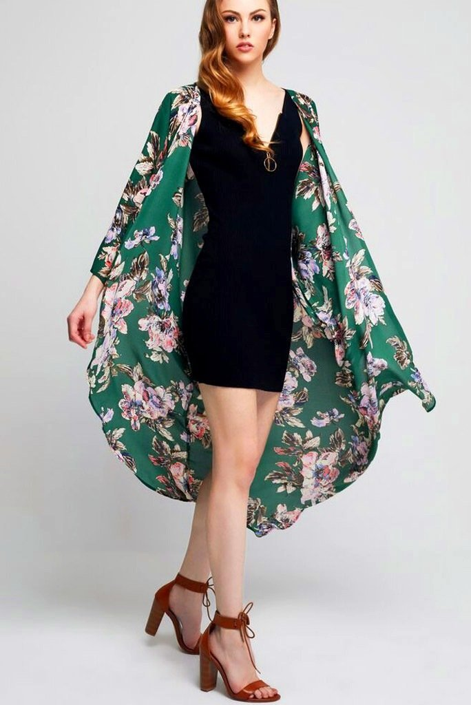 Model wearing long green kimono with floral prints front profile