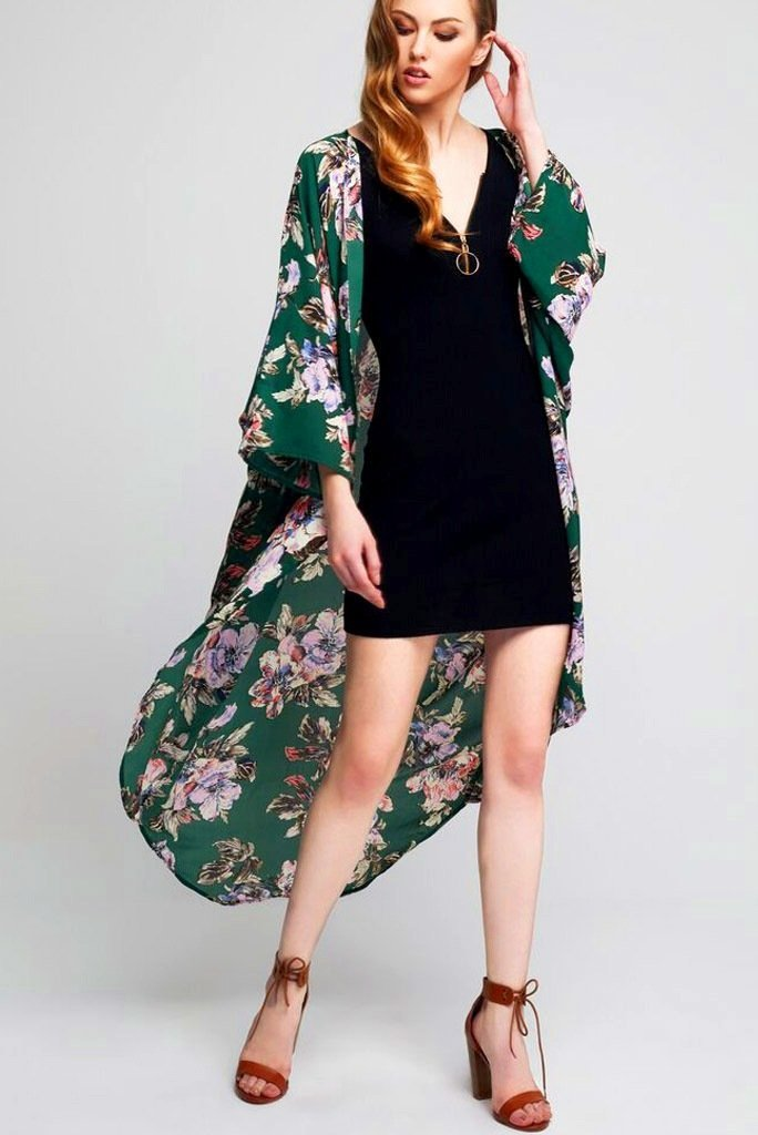 Model wearing long green kimono with floral prints
