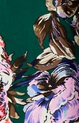 green crepe fabric with floral prints