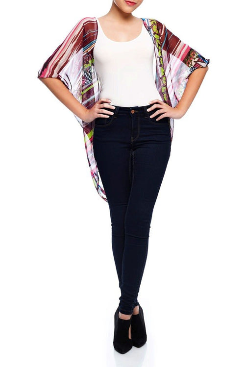 Model wearing short burgundy & pink kimono with whimsical prints facing front