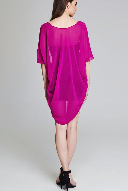 Model wearing short magenta chiffon kimono facing back