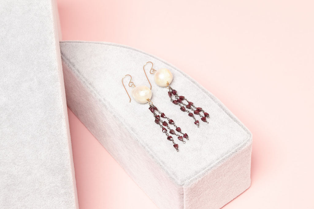 white pearls with streaming magenta gemstone beads earring on box