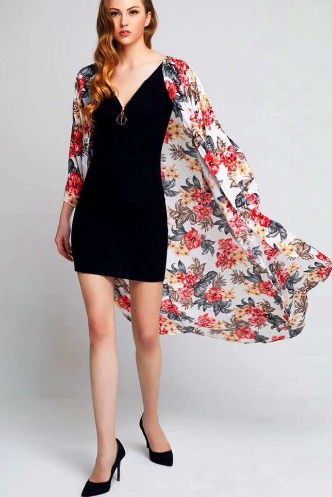 Model wearing long white crepe kimono with floral prints front facing