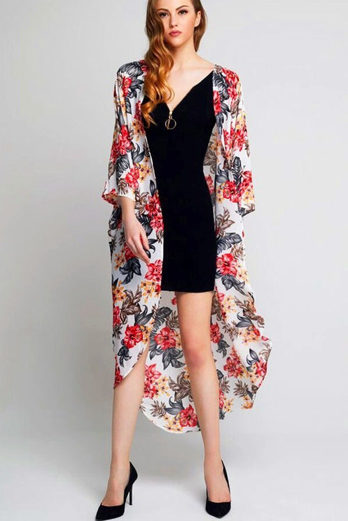 Model wearing long white crepe kimono with floral prints