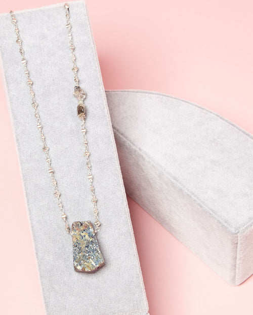 Necklace - druzy centerpiece with sparkling rondelles on its chain.
