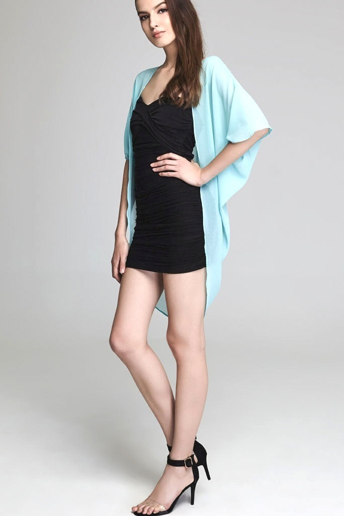 Model wearing short mint colored chiffon kimono facing left