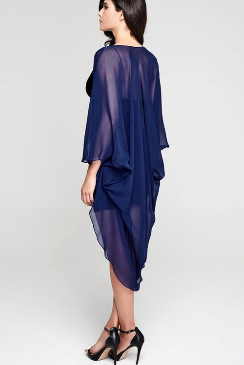 Model wearing 3 paneled dark blue silk kimono facing back