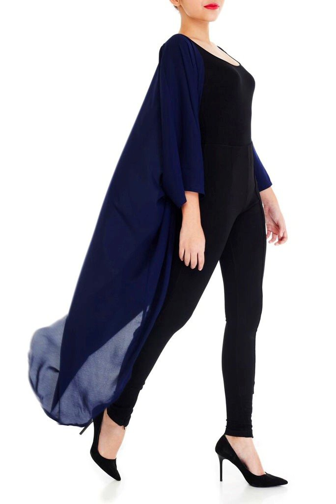 Model wearing long navy blue kimono facing right