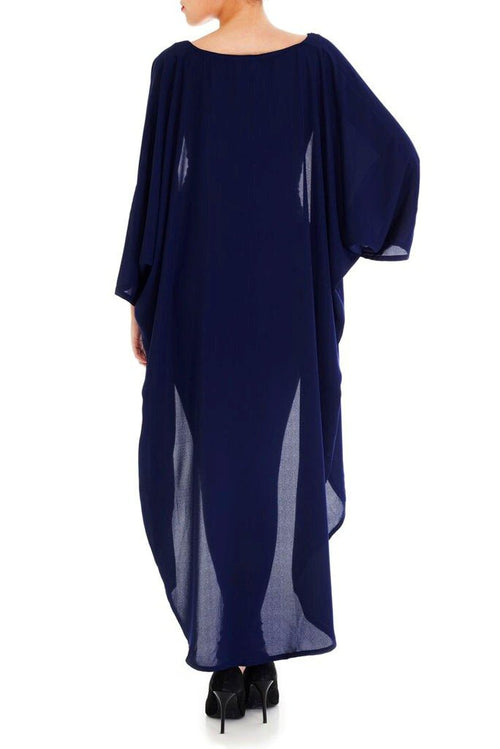 Model wearing long navy blue kimono facing back