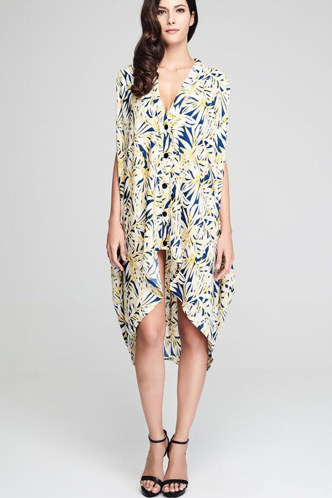 Model wearing blue crepe drape dress with yellow leafy prints front facing