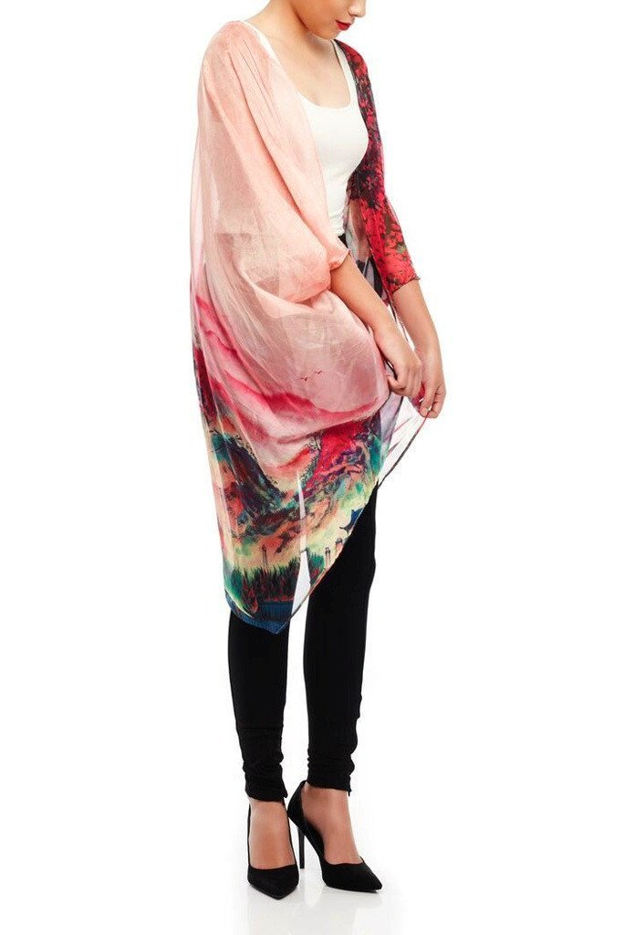Model wearing pink chiffon kimono with striking ombre prints facing right