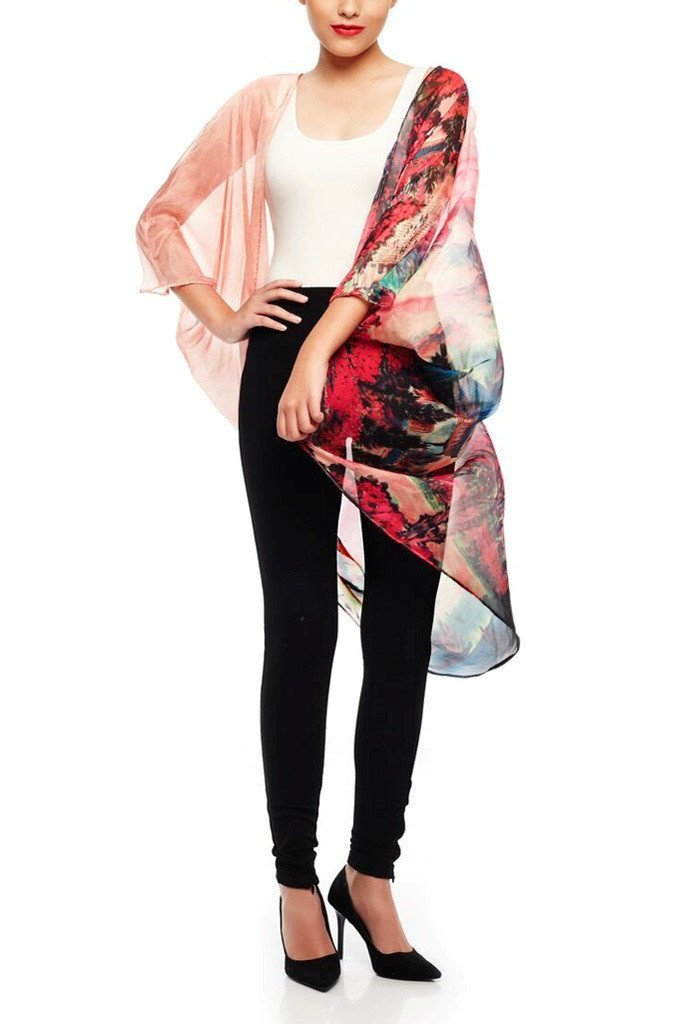 Model wearing pink chiffon kimono with striking ombre prints front profile