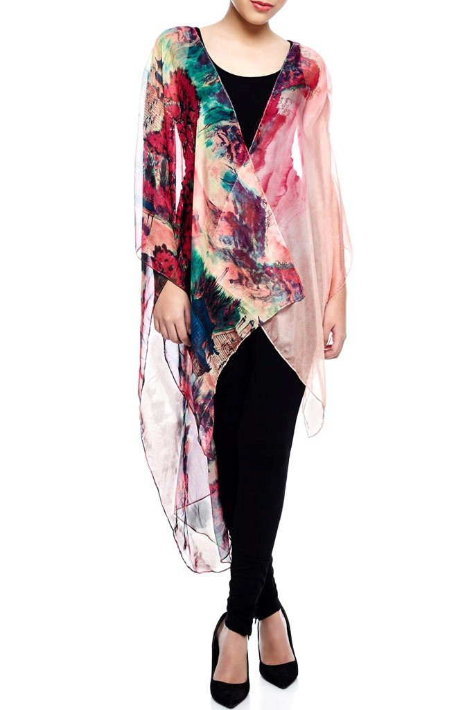 Model wearing pink throw with striking ombre print facing forward