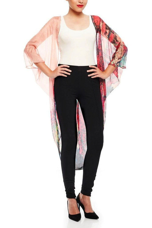 Model wearing pink chiffon kimono with striking ombre prints facing front