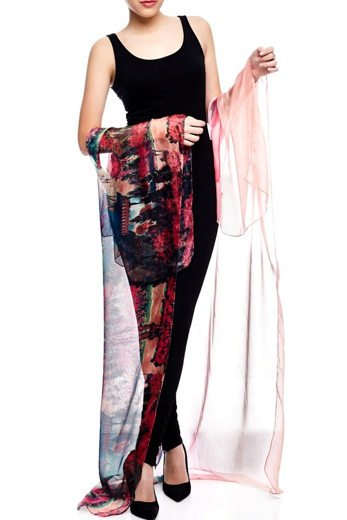 Model wearing pink throw with striking ombre print facing front