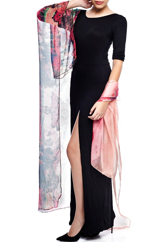 Model wearing pink throw with striking ombre print over black dress