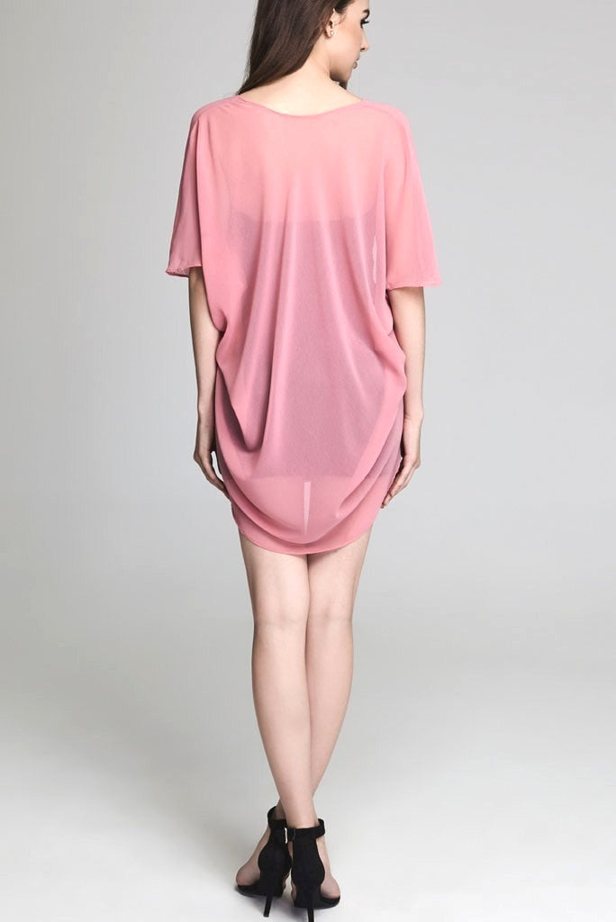 Model wearing short pink chiffon kimono facing back