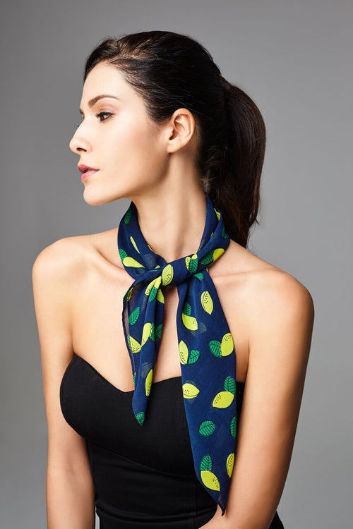 Model wearing blue scarf with lemon prints