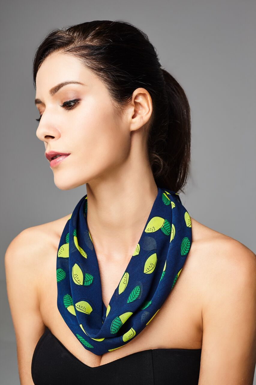 Model wearing blue scarf with lemon prints front facing