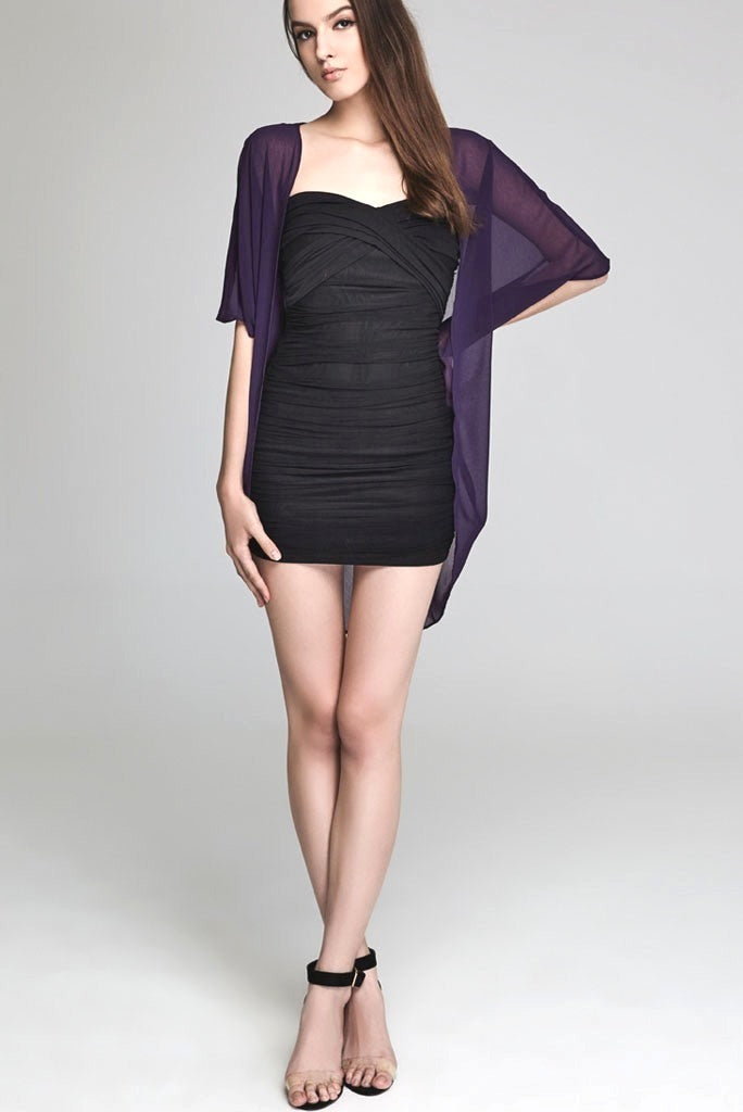 Model wearing short purple chiffon kimono facing forward