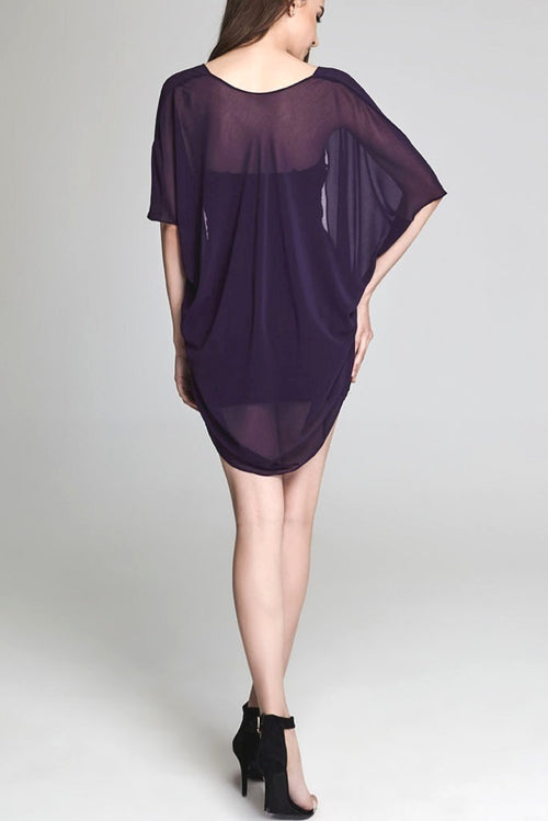 Model wearing short purple chiffon kimono facing back