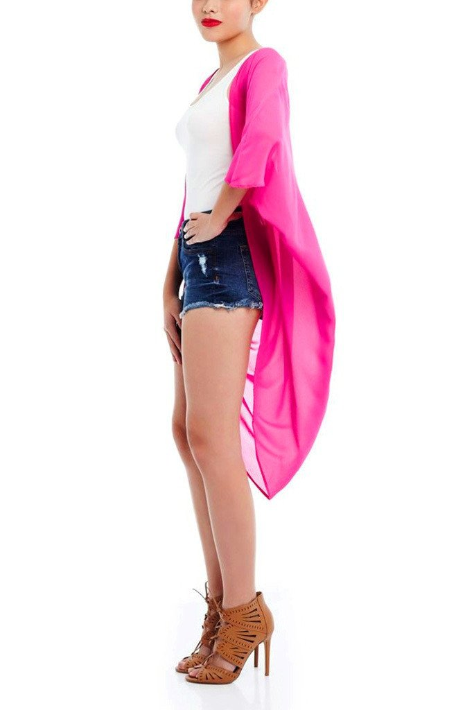 Model wearing magenta chiffon kimono facing left