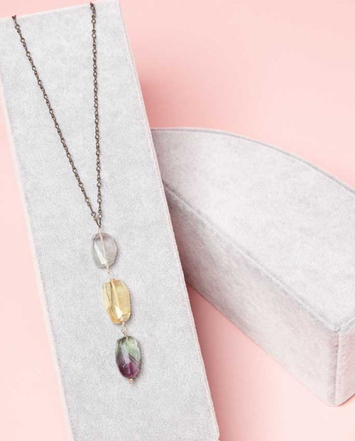 Necklace - Specially curated gems of dazzling hues of silver, lemon, emerald and purple.