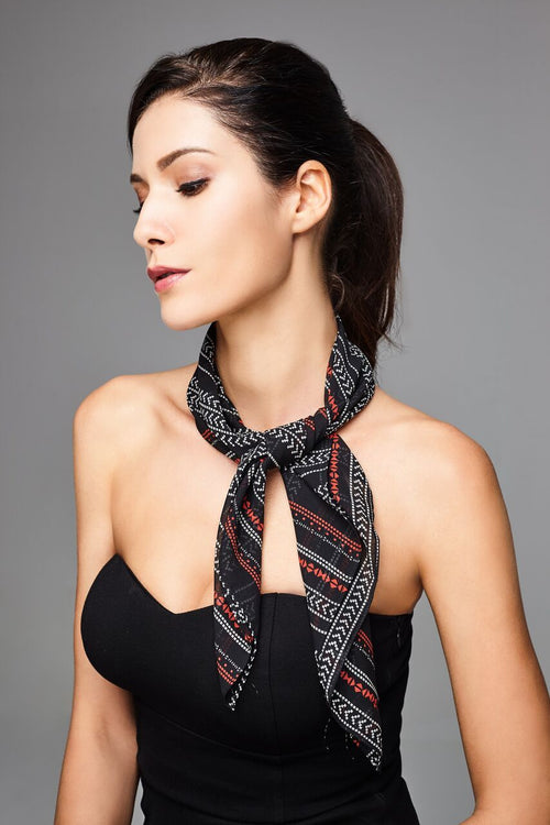 Model wearing dark grey scarf with lines
