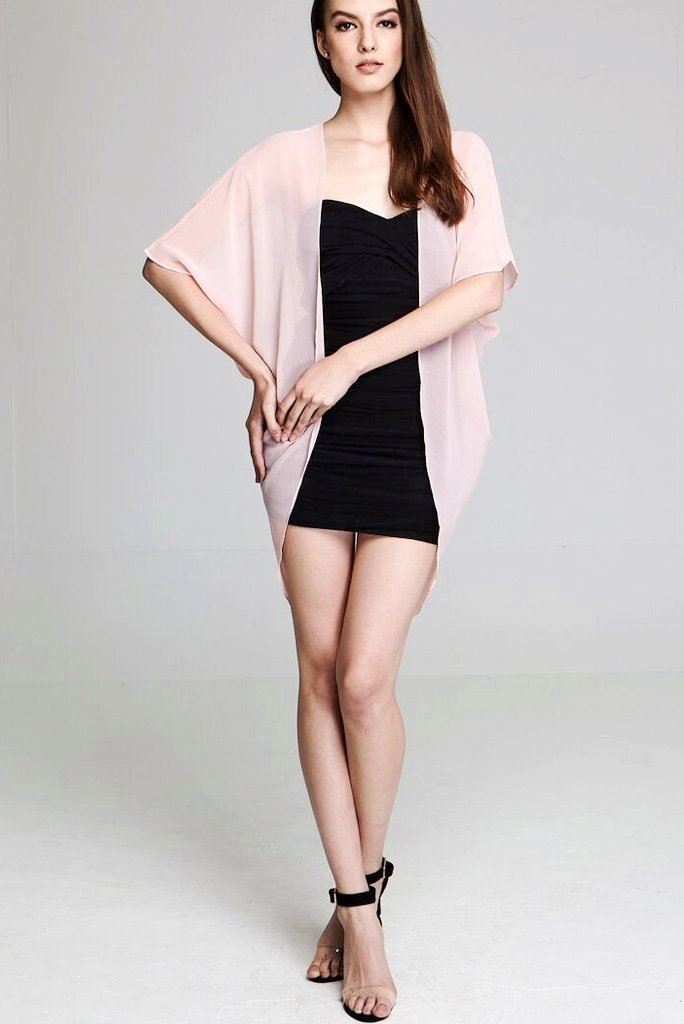 Model wearing short light pink chiffon kimono