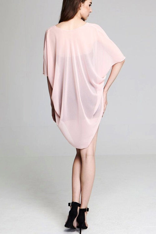 Model wearing short light pink chiffon kimono facing back