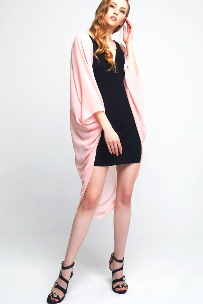 Model wearing light pink chiffon kimono facing side