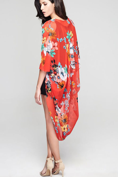 Model wearing cherry red chiffon kimono with floral prints facing back