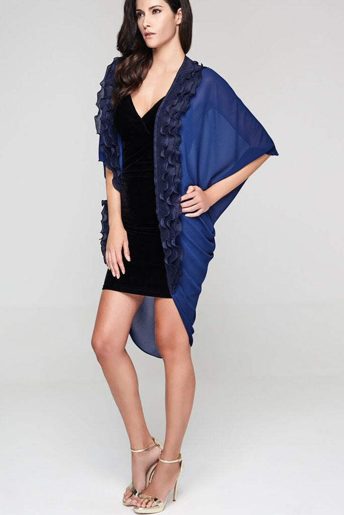 Model wearing navy blue kimono with a ruffle border in twilight blue.
