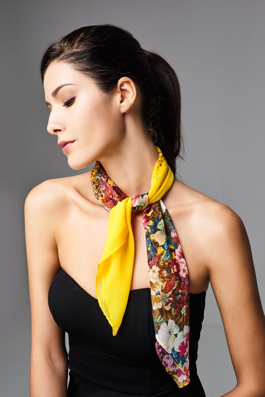 Model wearing yellow scarf with floral prints