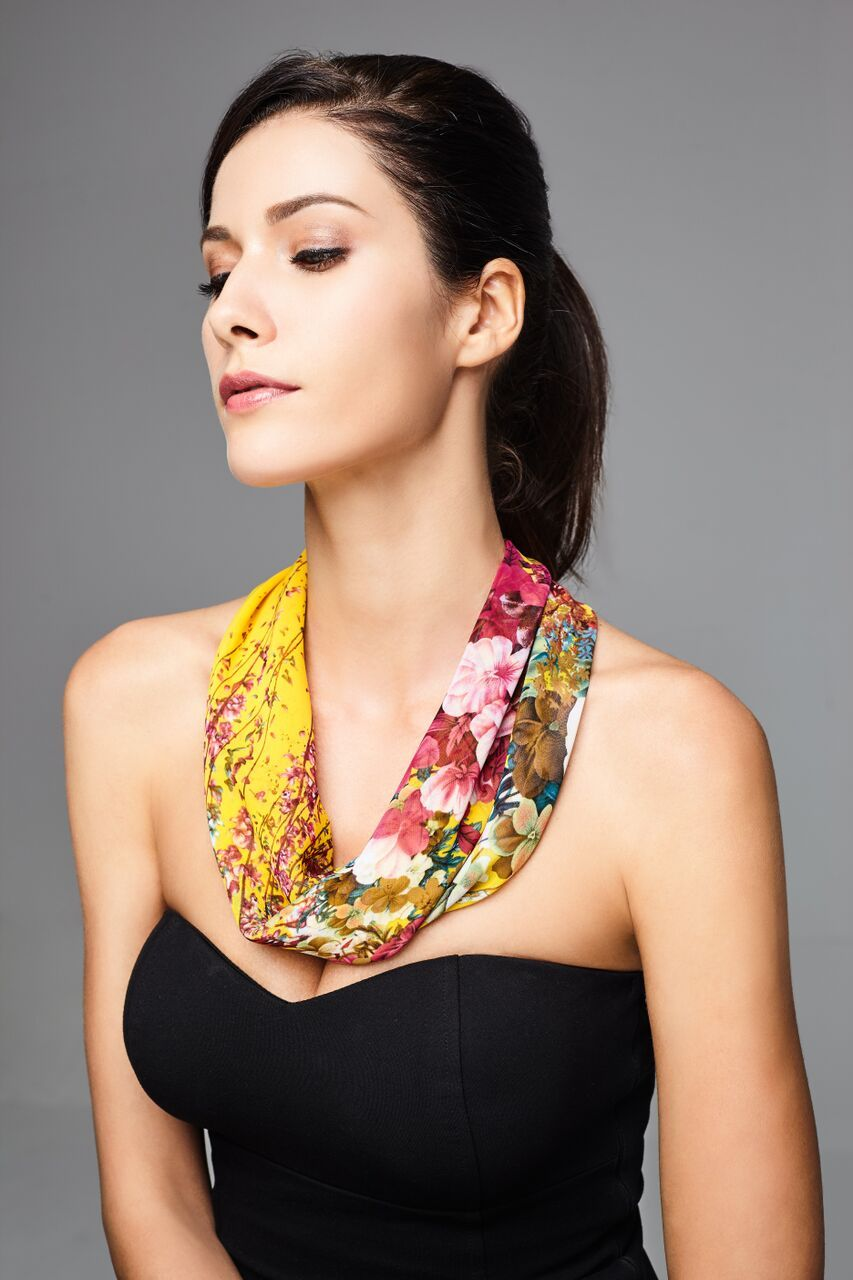 Model wearing yellow scarf with floral prints front profile