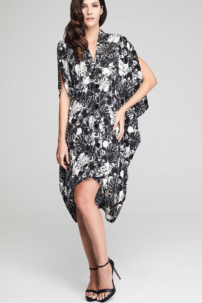 Model wearing black drape dress with white floral prints