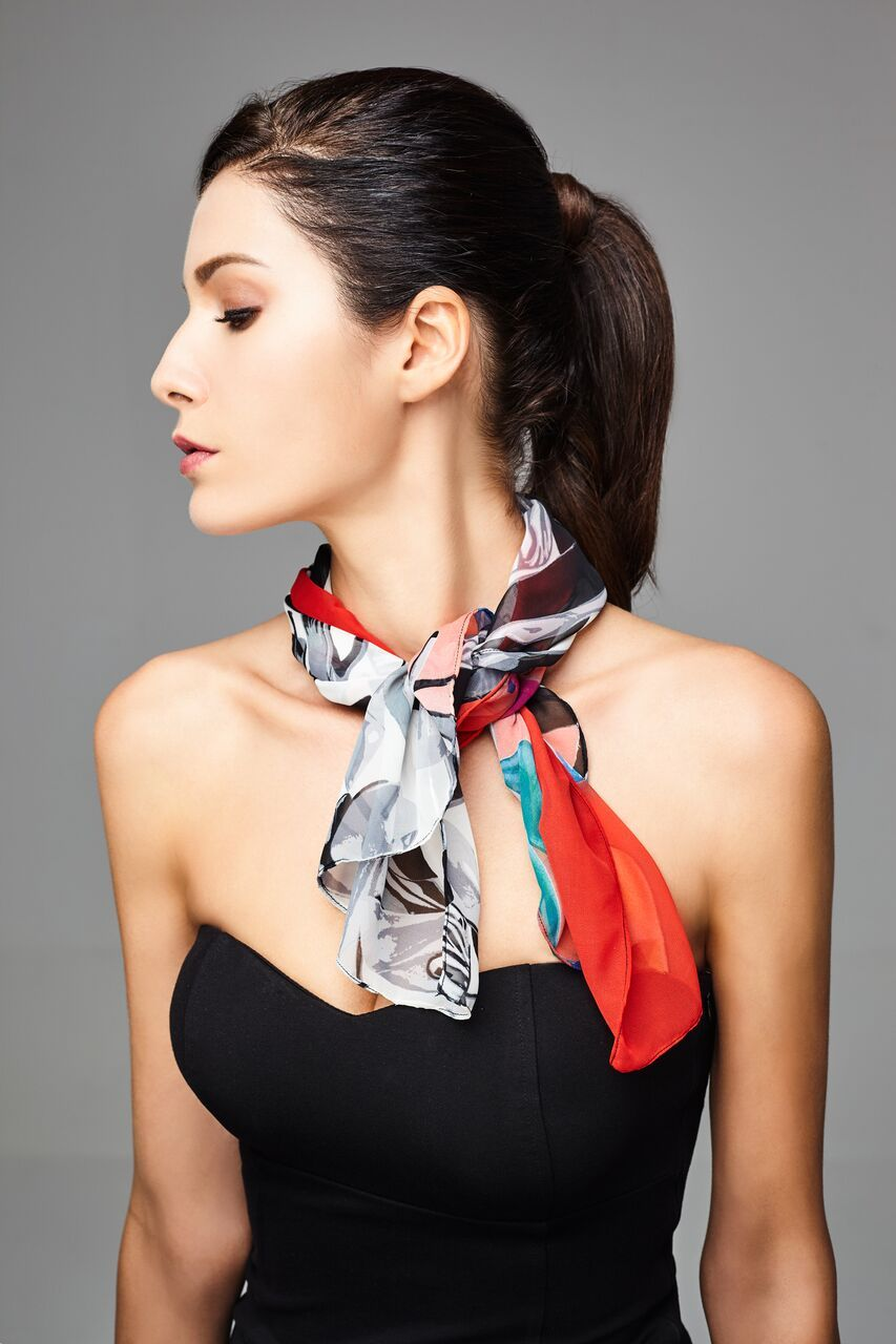 model wearing a scarf in a splash of monochrome & vibrant colors