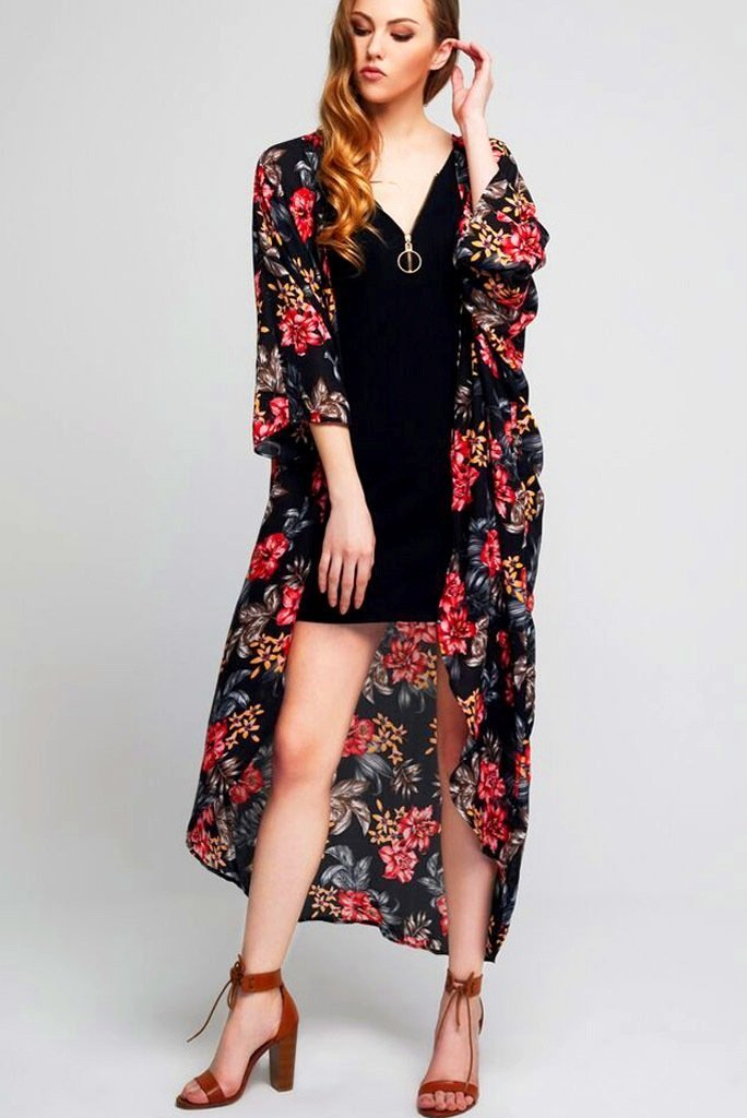 Model wearing long black crepe kimono with floral prints