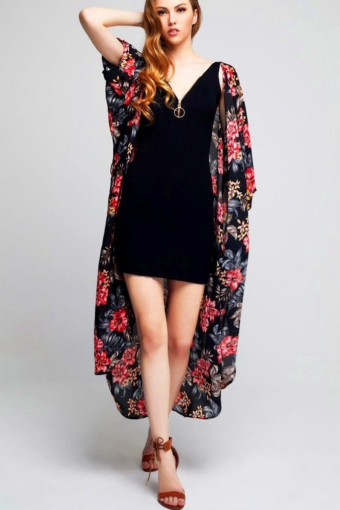 Model wearing long black crepe kimono with floral prints facing forward