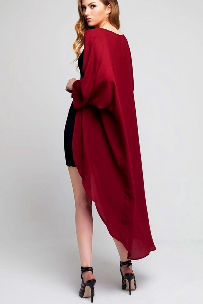 Model wearing long dark red crepe kimono