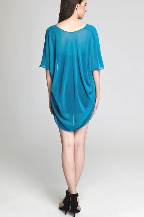 Model wearing short teal chiffon kimono facing back