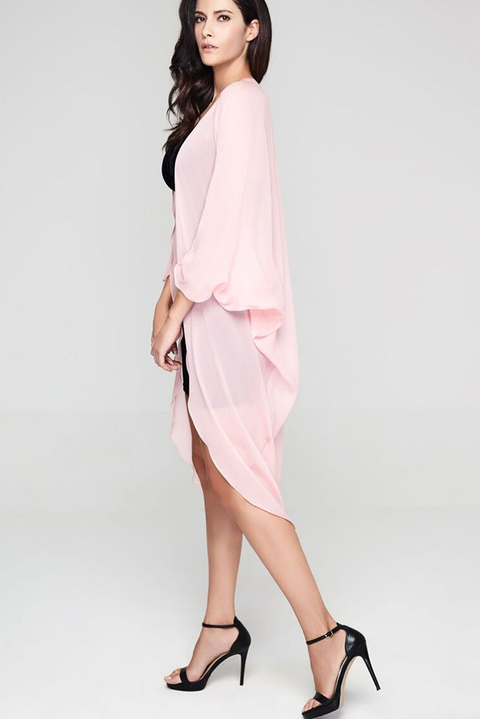 Model wearing pink silk kimono facing left