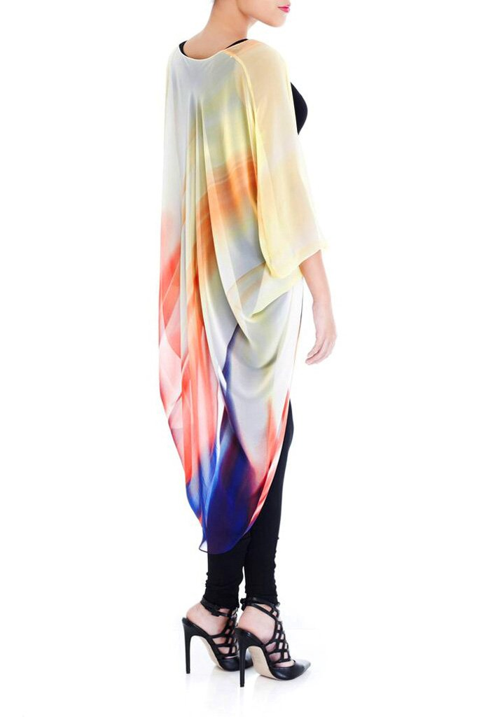 Model wearing chiffon kimono with brushes of color facing right