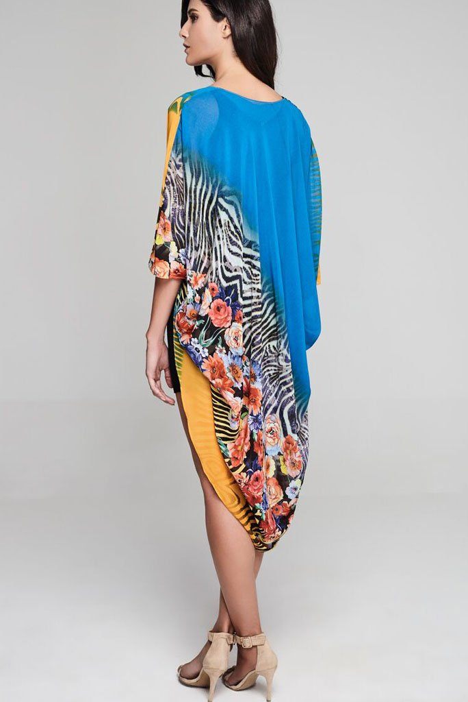 Model wearing golden and blue kimono with floral & animal prints